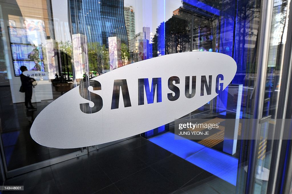 A logo of Samsung Electronics is seen on the glass door of its showroom in Seoul on April 27, 2012. South Korea's Samsung Electronics reported a record net profit of 5.05 trillion won (4.44 billion USD) in the first quarter, thanks largely to strong smartphone sales.