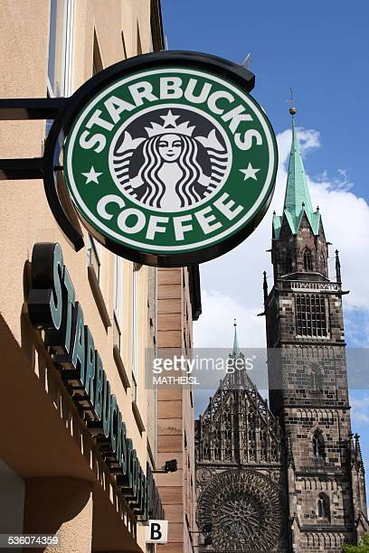 Logo of Starbucks coffee Shop on Wall of Building at Nürnberg Germany Europe