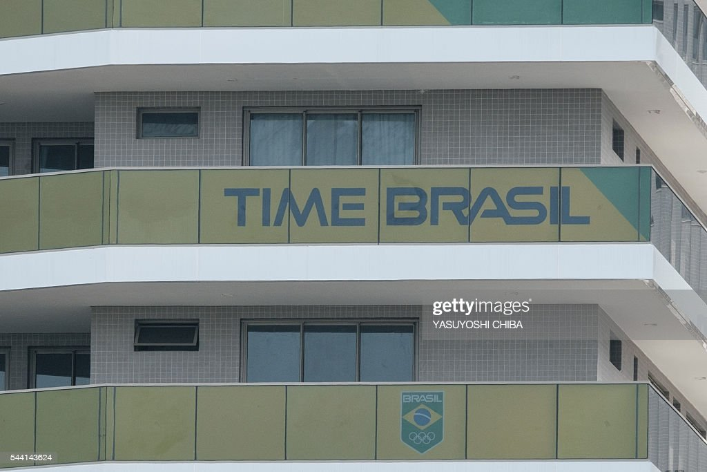 A logo of the Brazil Team and a sign reading 'Time Brazil' are view at te Olympic and Paralympic Village in Rio de Jnaeiro, Brazil, on July 1, 2016. / AFP / YASUYOSHI