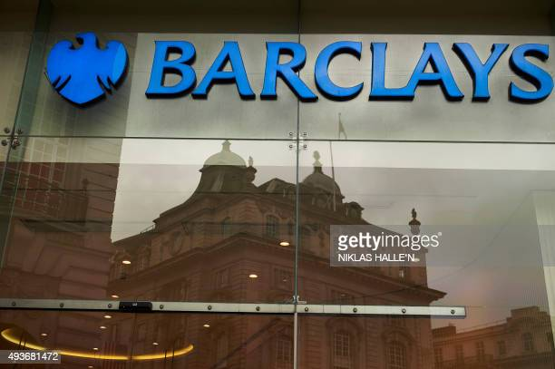 A logo of the British bank Barclays is seen on a sign outside a branch of the bank in London on October 22 2015 Britain's Competition and Markets...