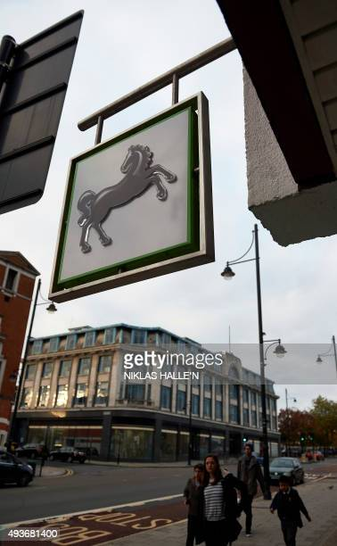 A logo of the British Lloyds bank is seen on a sign outside a branch of the bank in London on October 22 2015 Britain's Competition and Markets...
