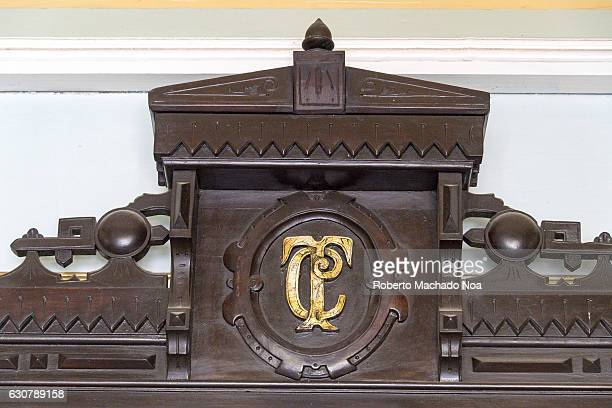 Logo of the Charity Theater or Teatro Caridad engraved on wooden upper part of an antique furniture