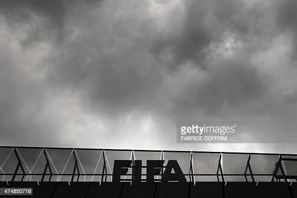 A logo of the FIFA is seen at the top of its headquarters on May 27 2015 in Zurich Swiss police raided a Zurich hotel to detain six top football...