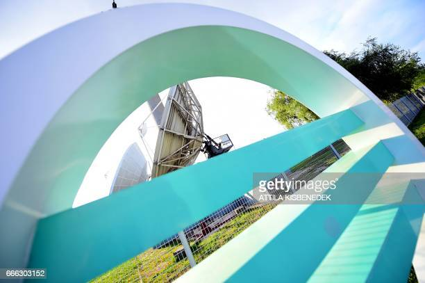 A logo of the M3 chanel of the Media Services and Support Trust Fund is seen in front of giant satalite dish antennas at their headquarter at the 3rd...
