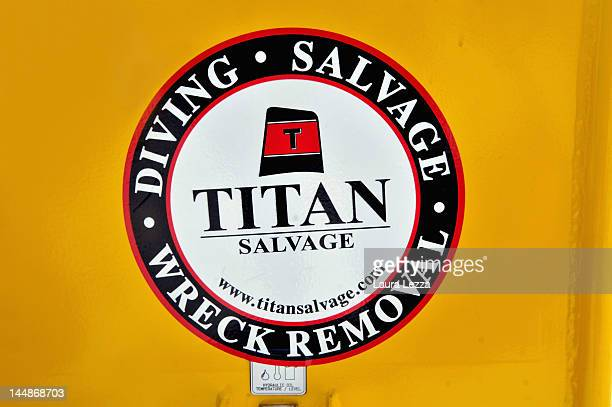 A logo of the salvage and wreck removal company Titan is seen a few days before operations to remove the capsized cruise liner are due to begin on...