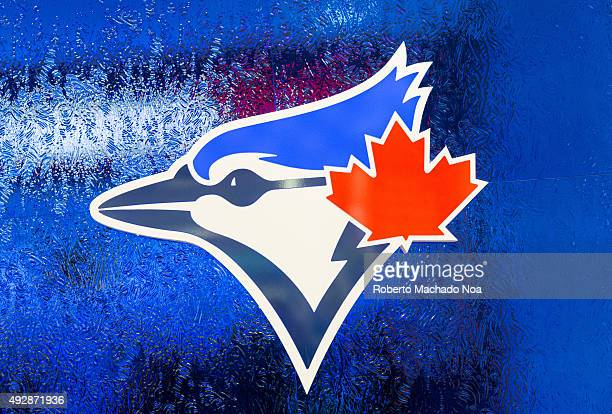 Logo of the Toronto Blue Jays baseball team on a blue frosted glass The logo features the head of the 'Blue Jay' bird and the Canadian maple leaf in...