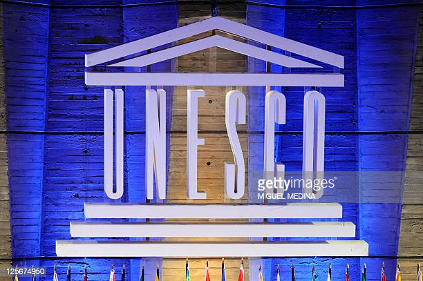 A logo of the United Nations Educational Scientific and Cultural Organization is displayed in front of the organization headquarters on September 14...