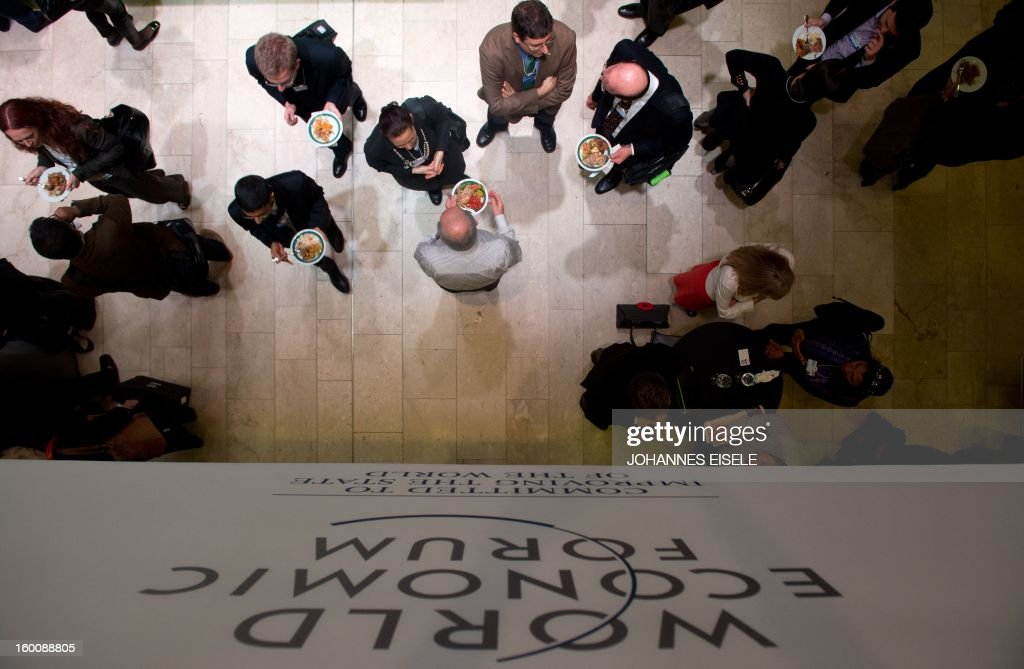 A logo of the World Economic Forum Annual Meeting 2013 is pictured on January 26, 2013 as people have lunch at the Swiss resort of Davos.