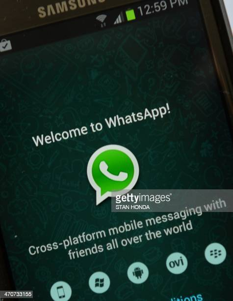 Logo of WhatsApp the popular messaging service bought by Facebook for USD $19 billion seen on a smartphone February 20 2014 in New York Facebook's...
