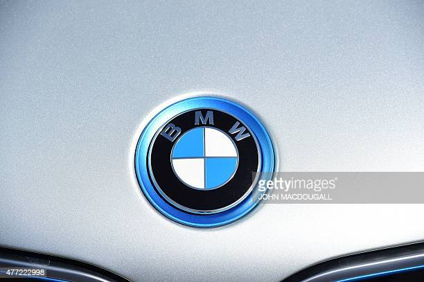 A BMW logo on an electric BMW car is seen on display in front of the Berlin Congress Centre during a twoday national conference on 'Electromobility'...