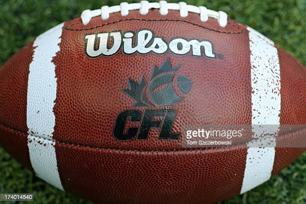 CFL logo on an official Canadian CFL league ball during warmups before the Saskatchewan Roughriders CFL game against the Toronto Argonauts on July 11...