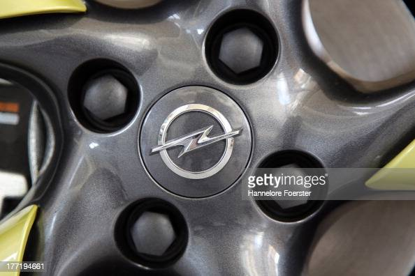 A logo on the hubcap of an Opel Adam at the Opel Ruesselsheim factory on August 22 2013 in Ruesselsheim Germany Opel which is owned by GM has gone...