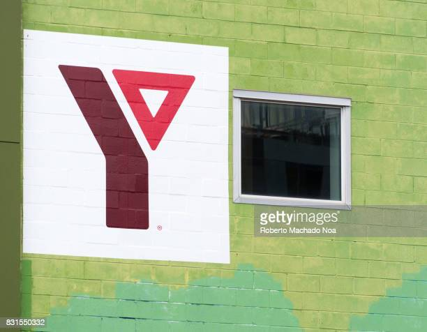 YMCA logo or sign in an old brick wall building The Young Men's Christian Association is a worldwide organization that aims to put Christian...