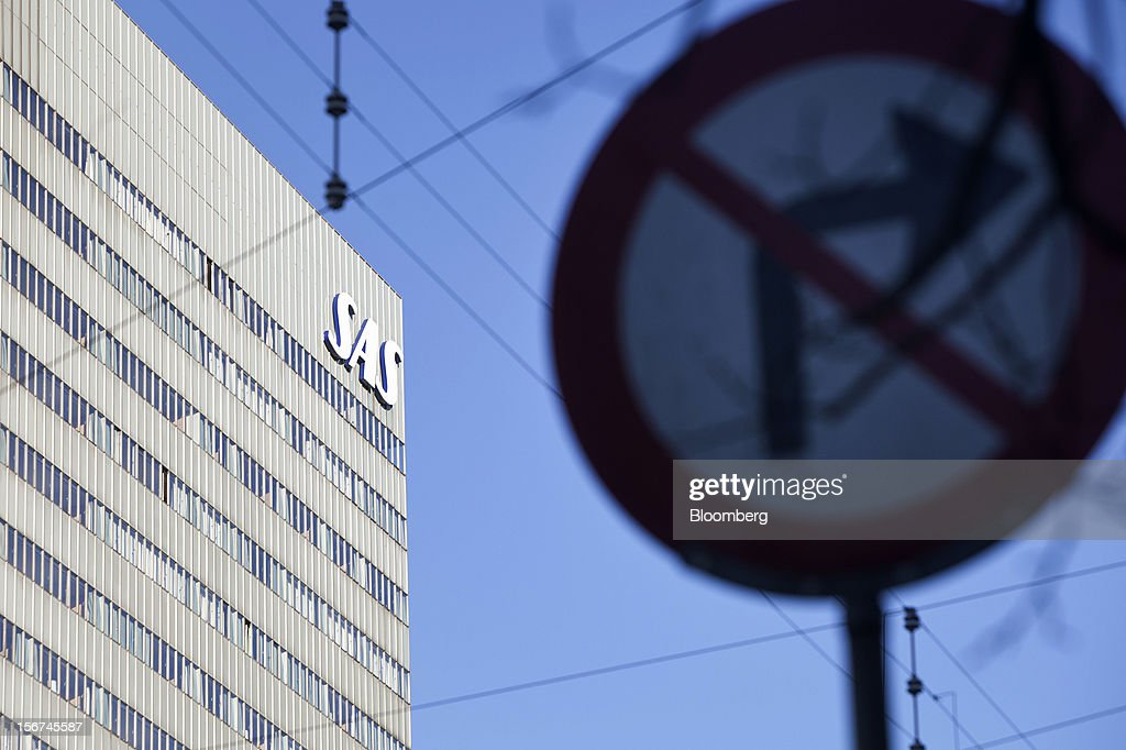 A logo outside the offices of SAS AB airlines is seen beyond a road traffic sign in central Copenhagen, Denmark, on Monday, Nov. 19, 2012. Denmark's two-year yields sank to the lowest in almost three months in Copenhagen trading as Europe's debt crisis continues to drive investors north. Photographer: Linus Hook/Bloomberg via Getty Images
