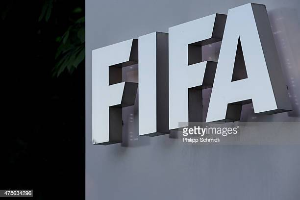 FIFA logo sign is displayed at the FIFA headquarters on June 2 2015 in Zurich Switzerland Joseph S Blatter resigned as president of FIFA The...