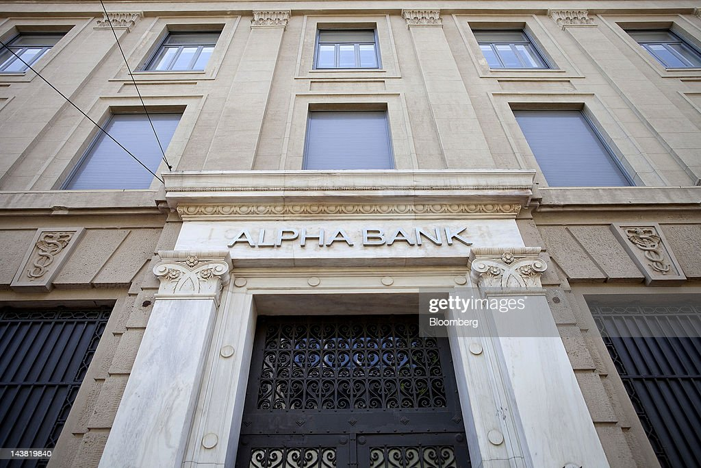 A logo sits above a doorway at the headquarters of Alpha Bank AE in Athens, Greece, on Friday, May 4, 2012. European stocks dropped as investors awaited today's American payrolls report and elections in France, Greece, Italy and Germany this weekend. Photographer: Simon Dawson/Bloomberg via Getty Images