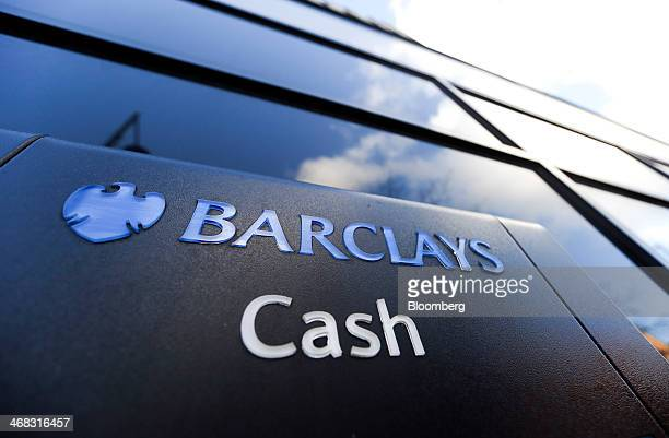 A logo sits above an automated teller machine outside a Barclays Plc bank branch in Barking UK on Friday Feb 7 2014 Barclays Plc reported fullyear...