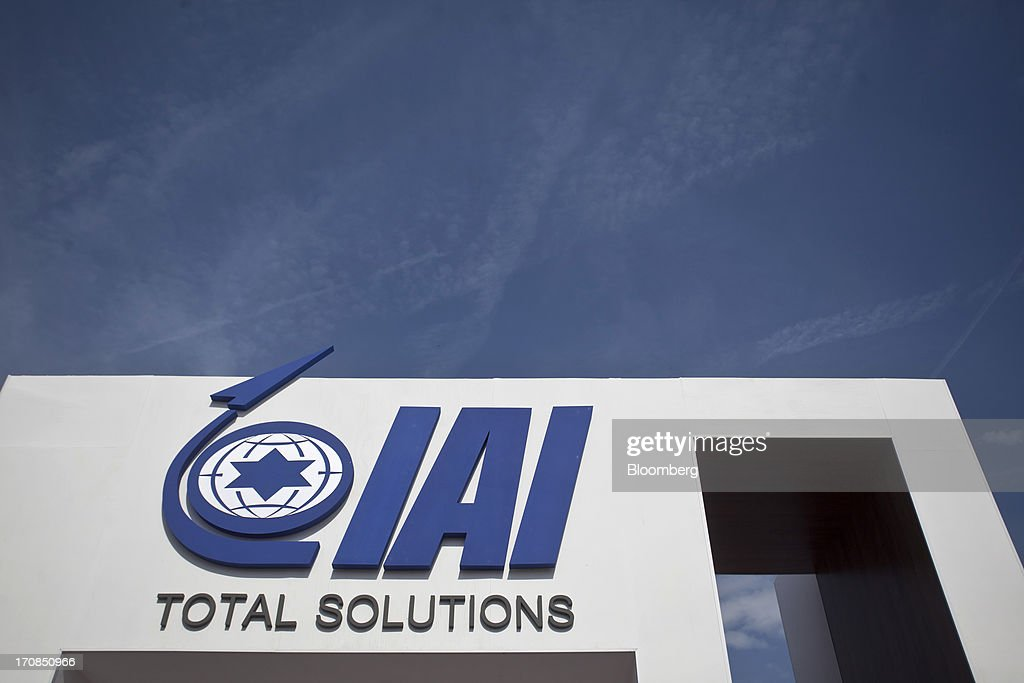 A logo sits above Israel Aerospace Industries Ltd.'s (IAI) company's stand on the second day of the Paris Air Show in Paris, France, on Tuesday, June 18, 2013. The 50th International Paris Air Show is the world's largest aviation and space industry show, and takes place at Le Bourget airport June 17-23. Photographer: Balint Porneczi/Bloomberg via Getty Images