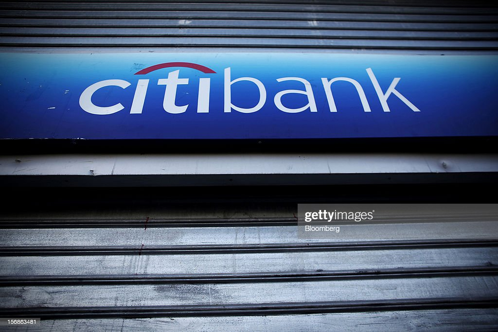 A logo sits above shutters outside a Citibank branch, operated by Citigroup Inc., in central Athens, Greece, on Thursday, Nov. 22, 2012. Citigroup Inc., the third-biggest U.S. bank by assets, said it will shutter almost half of its branches in Greece as European lawmakers continue a three-year struggle to fix the country's economy. Photographer: Angelos Tzortzinis/Bloomberg via Getty Images