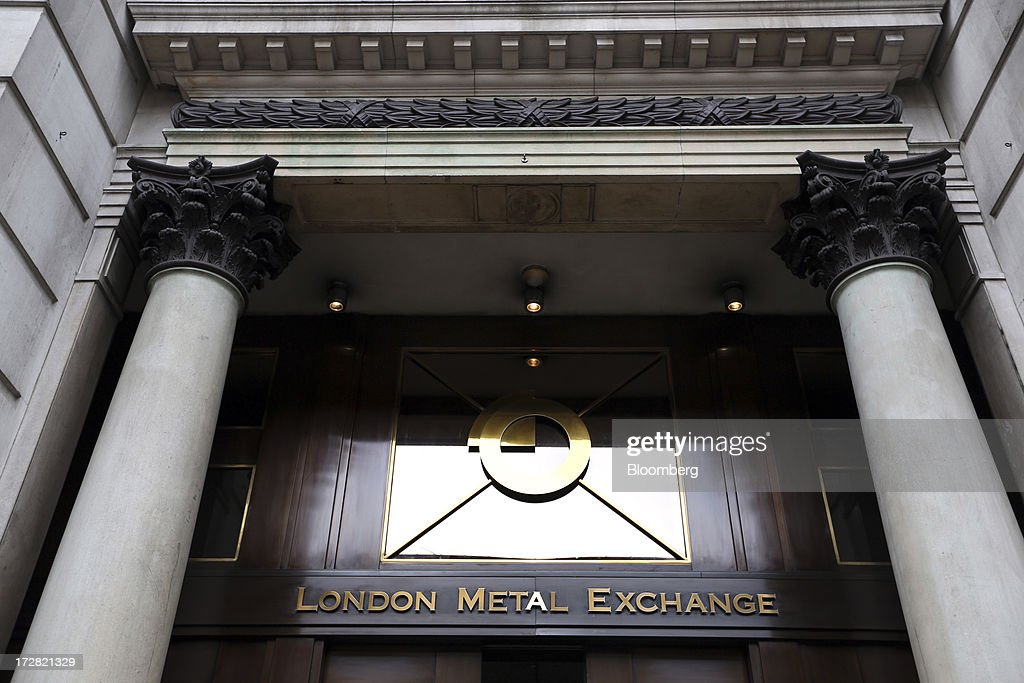 A logo sits above the entrance at the London Metal Exchange (LME) in London, U.K., on Wednesday, July 3, 2013. The London Metal Exchange's proposal to speed up deliveries of metal from its approved warehouses may lower aluminum and zinc premiums, Macquarie Group Ltd. said. Photographer: Chris Ratcliffe/Bloomberg via Getty Images