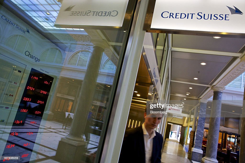 A logo sits above the entrance to a Credit Suisse Group AG bank branch in Zurich, Switzerland, on Wednesday, April 24, 2013. Credit Suisse Group AG, the second- biggest Swiss bank, posted a jump in first-quarter profit as year-earlier charges related to its own debt and bonus payments weren't repeated. Photographer: Gianluca Colla/Bloomberg via Getty Images