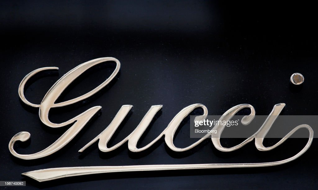 A logo sits above the entrance to a Gucci store, a luxury unit of France's PPR SA, in Rome, Italy, on Monday, Nov. 19, 2012. PPR SA, the French owner of the Gucci and Puma brands, said it's confident of revenue and profit growth in 2012. Photographer: Alessia Pierdomenico/Bloomberg via Getty Images