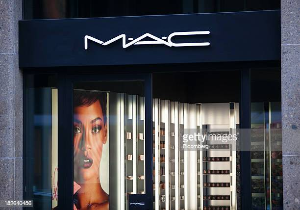 A logo sits above the entrance to a MAC Cosmetics Inc store operated by Estee Lauder Cos in Dusseldorf Germany on Tuesday Oct 1 2013 The Bundesbank...