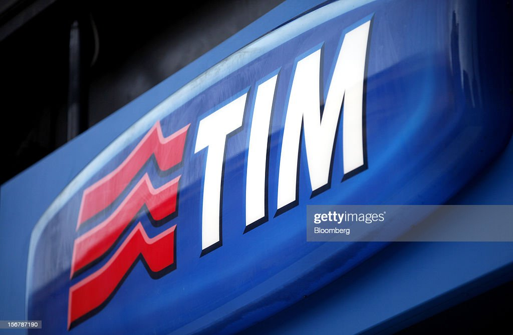 A logo sits above the entrance to a TIM store, the mobile unit of Telecom Italia SpA, in Milan, Italy, on Tuesday, Nov. 20, 2012. Telecom Italia SpA said it is still reviewing the possible spinoff of its fixed-line network and the company's board will discuss the outcome of its analysis on Dec. 6. Photographer: Alessia Pierdomenico/Bloomberg via Getty Images