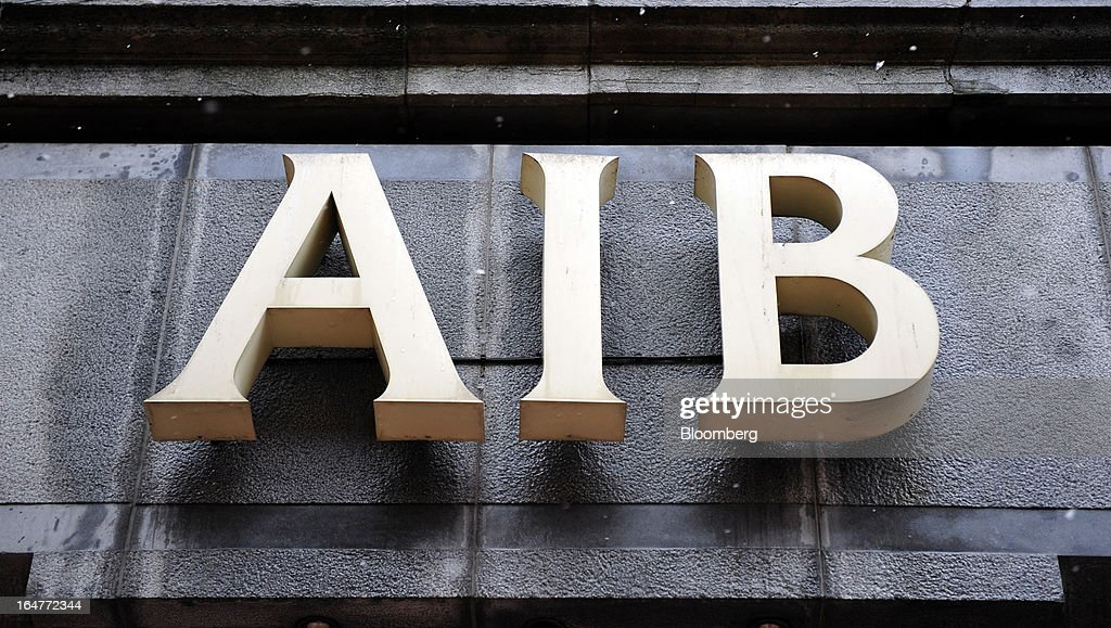 A logo sits above the entrance to an Allied Irish Banks Plc (AIB) branch on Grafton Street in Dublin, Ireland, on Wednesday, March 27, 2013. Allied Irish Banks Plc, which cost taxpayers about 21 billion euros ($27 billion) to rescue, said its annual loss widened as a decline in bad loan losses failed to offset dwindling gains from buying back its own debt. Photographer: Aidan Crawley/Bloomberg via Getty Images