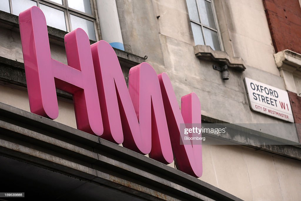 A logo sits above the entrance to an HMV store on Oxford Street in London, U.K., on Tuesday, Jan. 15, 2013. Endless LLP, a private-equity firm that focuses on companies in distress, contacted HMV Group Plc's prospective administrators with a view to buying the U.K.'s biggest retailer of CDs and DVDs. Photographer: Simon Dawson/Bloomberg via Getty Images