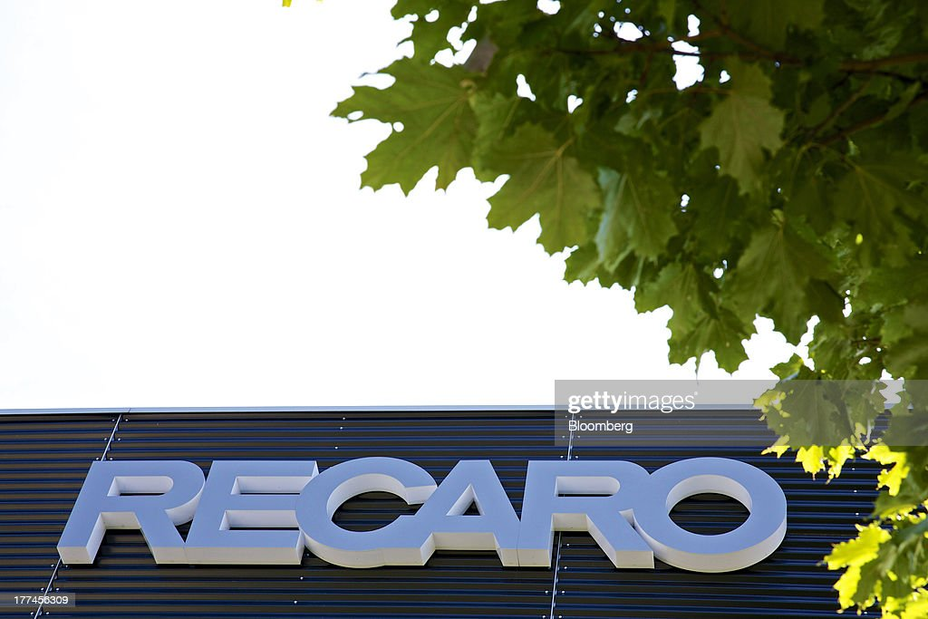 A logo sits above the entrance to Recaro Aircraft Seating GmbH & Co.'s assembly plant in Schwabish Hall, Germany, on Thursday, Aug. 22, 2013. Germany's economic growth in the second quarter was driven by consumption and a rebound in investment as a recovery in the 17-nation euro area, its biggest trading partner, bolstered confidence. Photographer: Gianluca Colla/Bloomberg via Getty Images