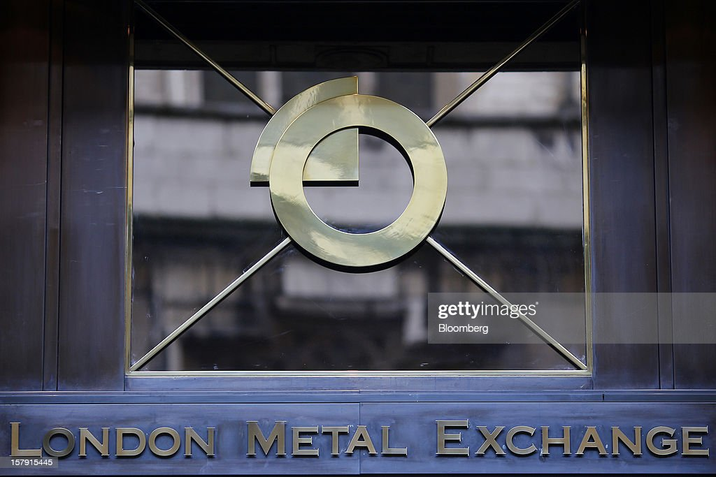 A logo sits above the entrance to the London Metal Exchange (LME) in London, U.K., on Friday, Dec. 7, 2012. The London Metal Exchange's $2.2 billion takeover by the Hong Kong Exchanges & Clearing Ltd. was completed yesterday. Photographer: Simon Dawson/Bloomberg via Getty Images