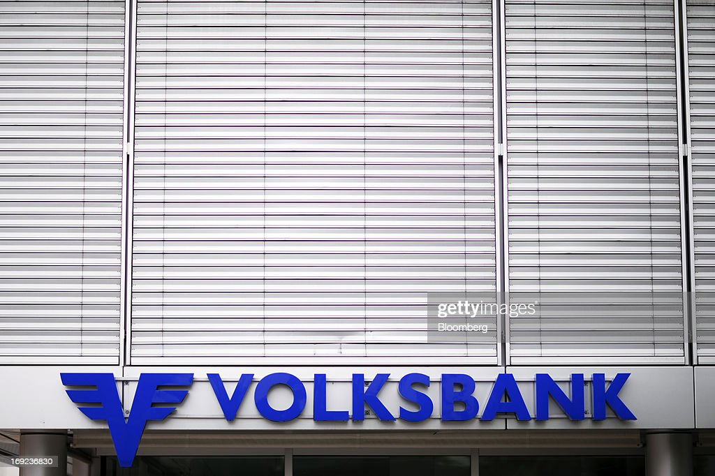 A logo sits above the entrance to Volksbank AG's offices in Schaan near Vaduz, Liechtenstein, on Tuesday, May 21, 2013. Liechtenstein, an alpine principality once fabled for its banking secrecy laws, remains a place favored by billionaires to stash the holding companies and investment entities that control their assets. Photographer: Valentin Flauraud/Bloomberg via Getty Images