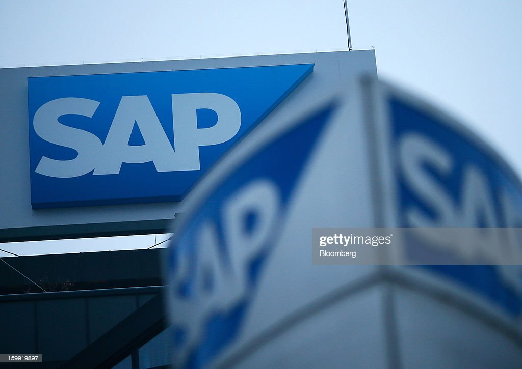 A logo sits above the SAP AG headquarters in Walldorf, Germany, on Wednesday, Jan. 23, 2013. SAP AG, the biggest maker of business-management software, forecast at least a 12 percent gain in full-year earnings as it adds Internet-based programs to attract users and fend off competition from Oracle Corp. Photographer: Ralph Orlowski/Bloomberg via Getty Images