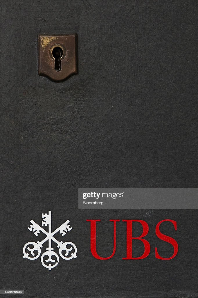 A logo sits beneath the lock of a mailbox at a UBS AG bank branch in Geneva, Switzerland, on Tuesday, May 1, 2012. UBS AG will post first quarter earnings earnings on May 2. Photographer: Valentin Flauraud/Bloomberg via Getty Images