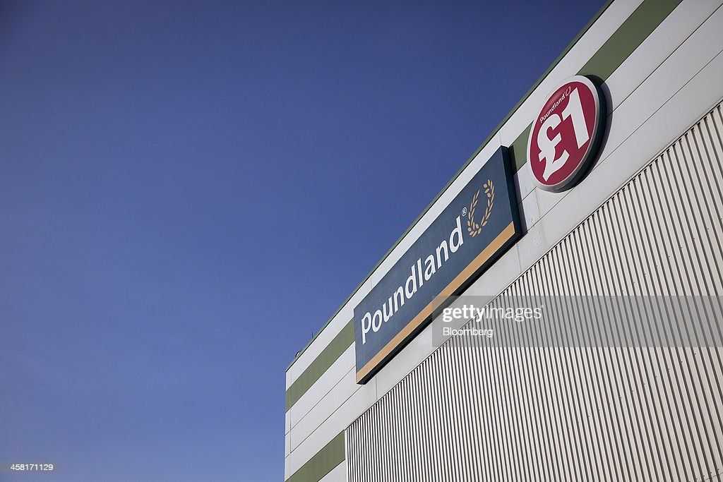 A logo sits beside a one pound price sign outside Poundland's goods distribution warehouse, operated by Poundland Holdings Ltd., in Bilston, U.K., on Friday, Dec. 20, 2013. U.K. discount retailer Poundland has hired Rothschild to manage its IPO, according to the Sunday Times newspaper. Photographer: Simon Dawson/Bloomberg via Getty Images