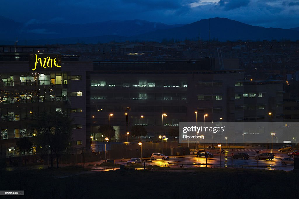 A logo sits illuminated above the offices at the offices of Jazztel Plc in Alcobendas, Spain, on Thursday, April 4, 2013. Jazztel almost doubled its share of the Spanish broadband market from 2009 to 2012 as it focused mostly on the fixed-telephone business through a reliable and affordable product that has gained popularity among debt-strapped Spaniards. Photographer: Angel Navarrete/Bloomberg via Getty Images
