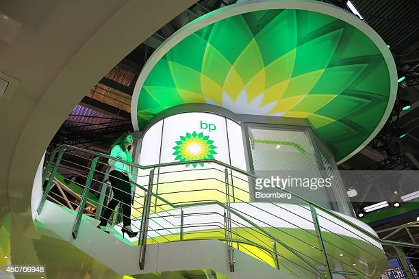 A logo sits illuminated at the BP Plc corporate pavilion during the 21st World Petroleum Congress in Moscow Russia on Monday June 16 2014 Work...