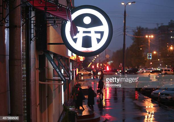 A logo sits illuminated outside a Planeta Sushi restaurant operated by Rosinter Restaurants Holding OJSC at dusk in Moscow Russia on Thursday Oct 18...