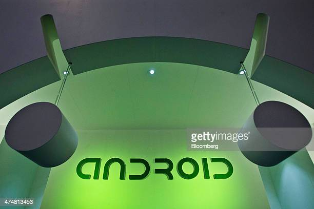 A logo sits illuminated outside the Android operating system pavilion on day two of the Mobile World Congress in Barcelona Spain on Tuesday Feb 25...