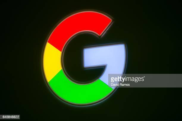 A logo sits illuminated outside the Google pavilion during the Mobile World Congress 2017 on the opening day of the event at the Fira Gran Via...