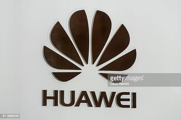 A logo sits illuminated outside the Huawei pavilion on the opening day of the World Mobile Congress at the Fira Gran Via Complex on February 22 2016...