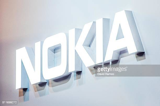 A logo sits illuminated outside the Nokia pavilion on the opening day of the World Mobile Congress at the Fira Gran Via Complex on February 22 2016...