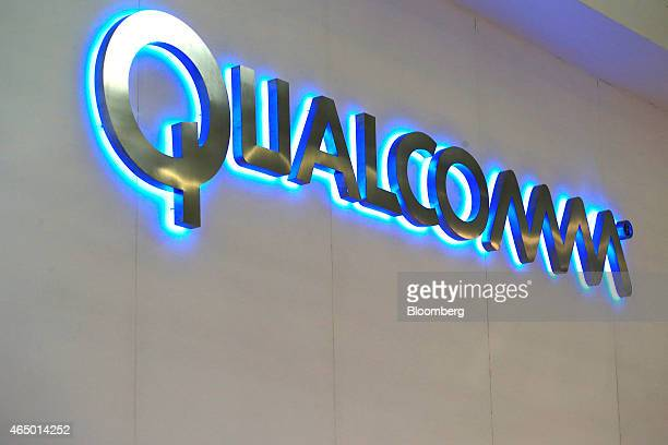 A logo sits illuminated outside the Qualcomm Inc pavilion at the Mobile World Congress in Barcelona Spain on Monday March 2 2015 The event which...