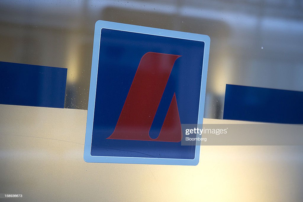 A logo sits in the window of a Landsbankinn hf bank branch in Reykjavik, Iceland, on Wednesday, Jan. 2, 2013. Iceland's inflation rate eased in December as central bank efforts to stabilize the krona with interest rate increases paid off. Photographer: Arnaldur Halldorsson/Bloomberg via Getty Images