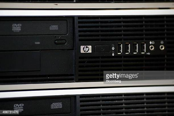 A HP logo sits near the USB ports of a desktop computer produced by HewlettPackard Co in a warehouse in this arranged photograph taken in London UK...