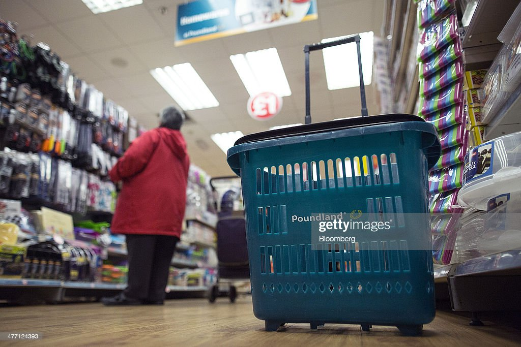 A logo sits on a a customer's shopping basket inside a Poundland discount store, operated by Poundland Group Plc in London, U.K., on Friday, March 7, 2014. Poundland Group Plc has demand for all the shares it is selling in an initial public offering that will value the U.K. discount retailer at as much as 750 million pounds ($1.3 billion), according to terms of the deal. Photographer: Simon Dawson/Bloomberg via Getty Images