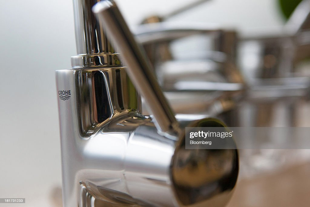 A logo sits on a bathroom tap, manufactured by Grohe Group, inside a bathroom store in Berlin, Germany, on Tuesday, Sept. 24, 2013. Lixil Corp., a Japanese toilet maker, is in advanced talks to buy German bathroom-fixtures company Grohe Group for more than 3 billion euros ($4 billion), according to people with knowledge of the matter. Photographer: Krisztian Bocsi/Bloomberg via Getty Images