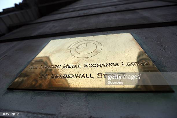 A logo sits on a brass plaque outside the entrance to the London Metal Exchange on Leadenhall Street in London UK on Tuesday Feb 3 2015 The London...