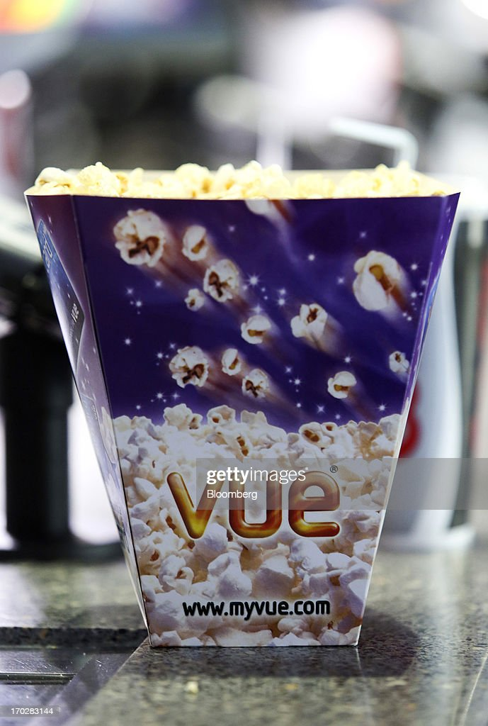 A logo sits on a carton of popcorn on a sales counter inside a Vue Cinema, operated by Vue Entertainment Ltd., at the Westfield Stratford City retail complex in London, U.K., on Tuesday, June 4, 2013. Vue Entertainment, the U.K. cinema chain bought by private equity firm Doughty Hanson & Co., are continuing to expand in Europe, recently acquiring Poland's second-largest cinema chain Multikino. Photographer: Chris Ratcliffe/Bloomberg via Getty Images